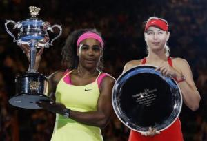 Williams of the U.S. and Sharapova of Russia pose with their trophies after their women's singles final match at the Australian Open 2015 tennis tournament in Melbourne